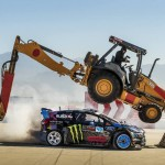 Ken Block sliding under a back hoe filming for Gymkhana 6.